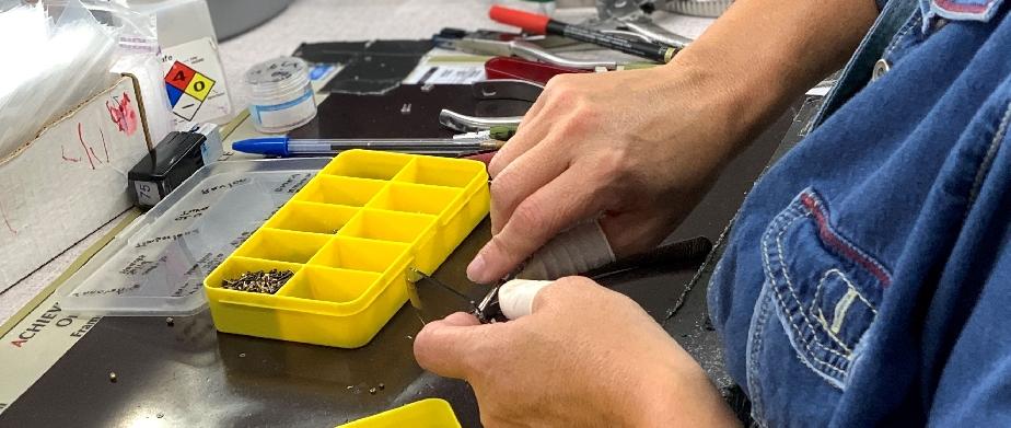 picture of lab tech adjusting frames